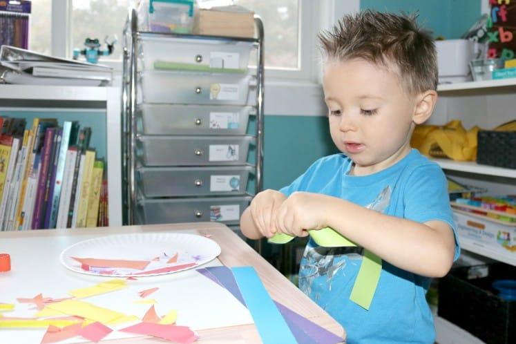 preschooler tearing cardstock