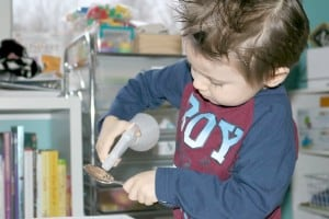 preschooler squirting water onto spoon