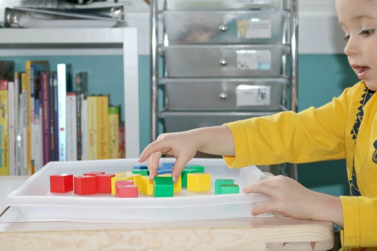preschooler playing with manipulative blocks