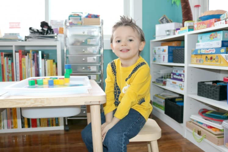 preschooler sitting at table with math manipulatives