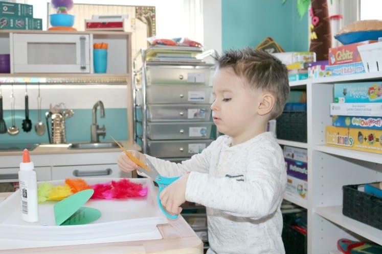 preschooler cutting beak for paper bird craft