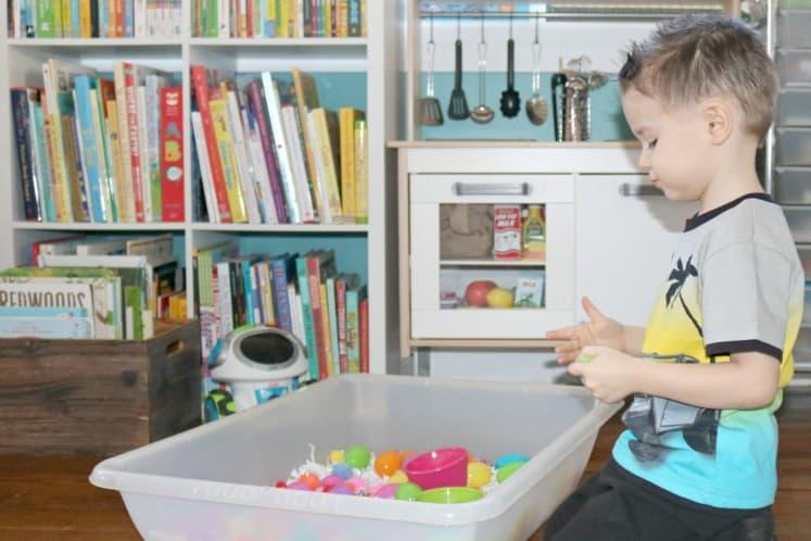 preschooler exploring Easter sensory bin