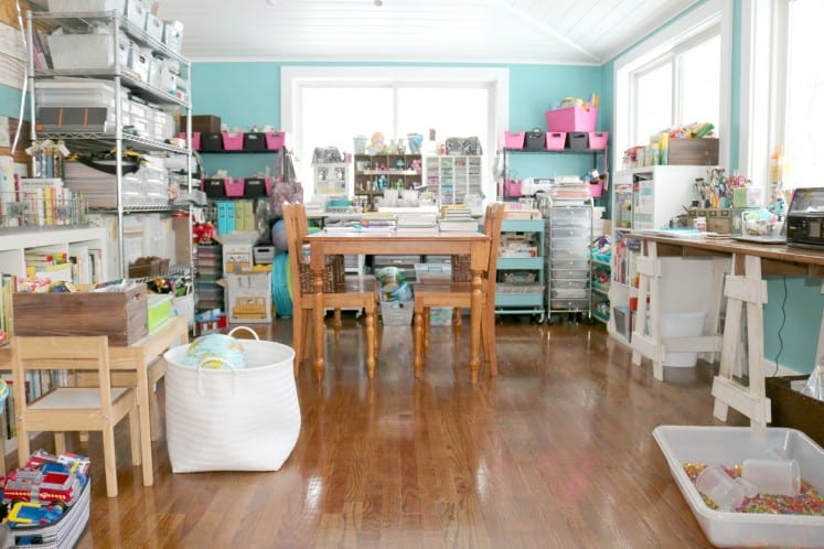 shared craft room featuring a wooden table and chairs as well as a child's table and chairs