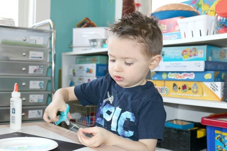 preschooler cutting cardstock