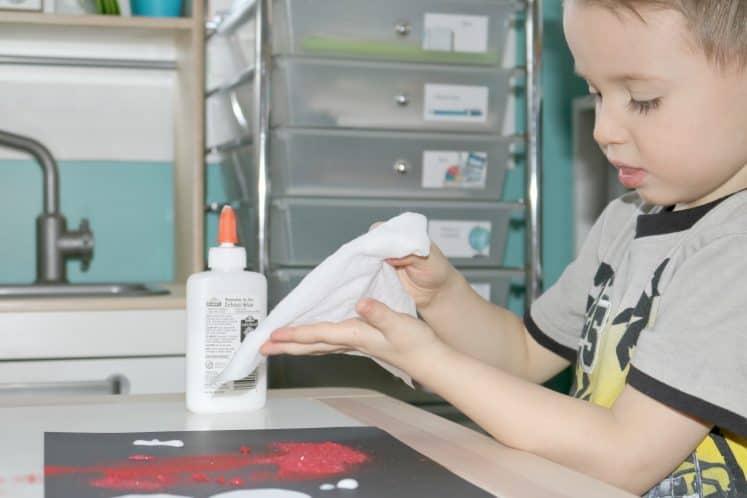 preschooler wiping off hands