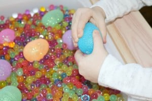 preschooler exploring blue sparkly plastic egg