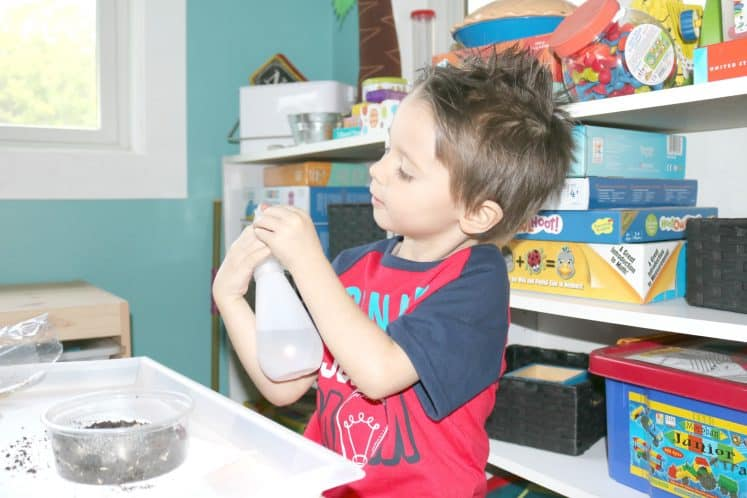 preschooler adjusting water bottle nozzle