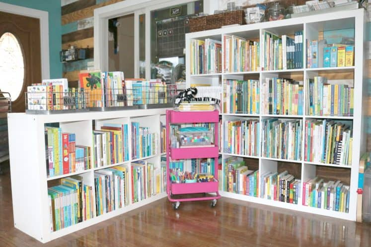 rolling cart in front of perpendicular cube bookshelves filled with books