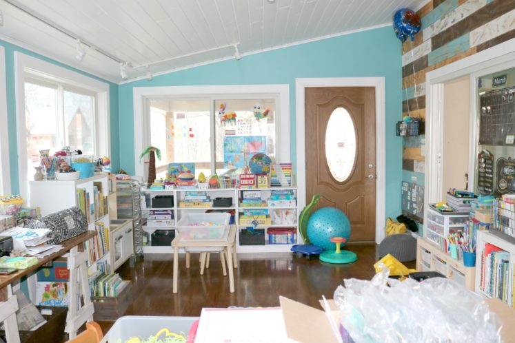 child's play area with toys, puzzles and games organized on shelves
