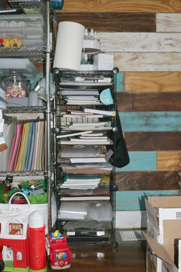 wire shelf filled with projects and planners
