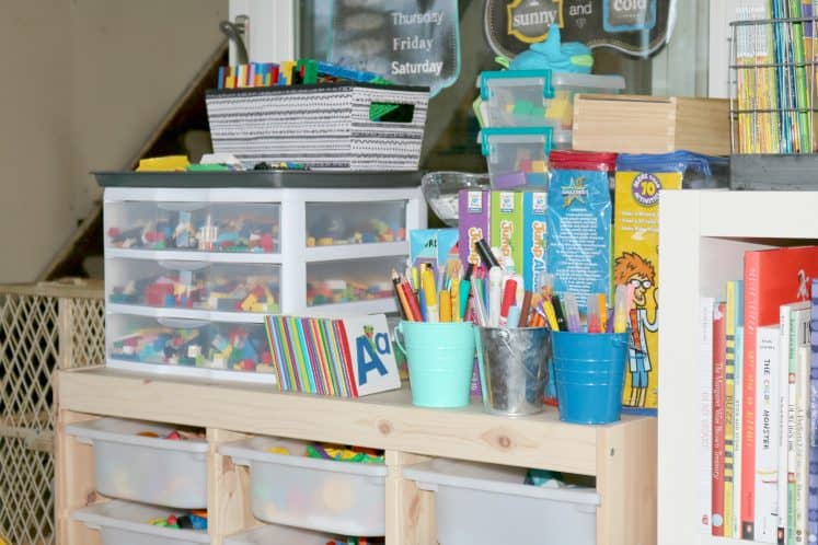 shelf with science and building supplies, art materials and manipulatives