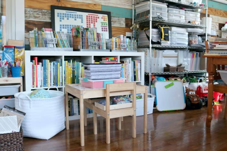 child's table and chairs in front of cube book shelves