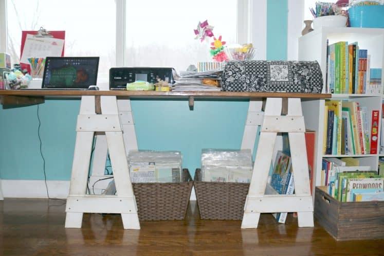 desk workspace with laptop, printer, and digital cutting machine