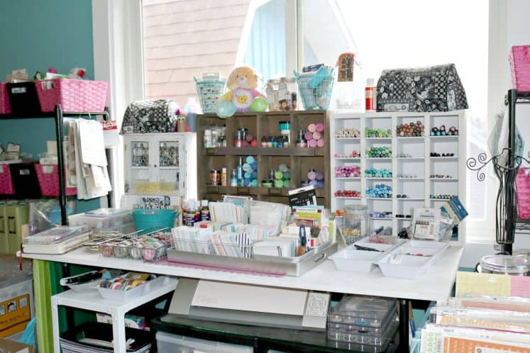craft workspace cluttered with supplies