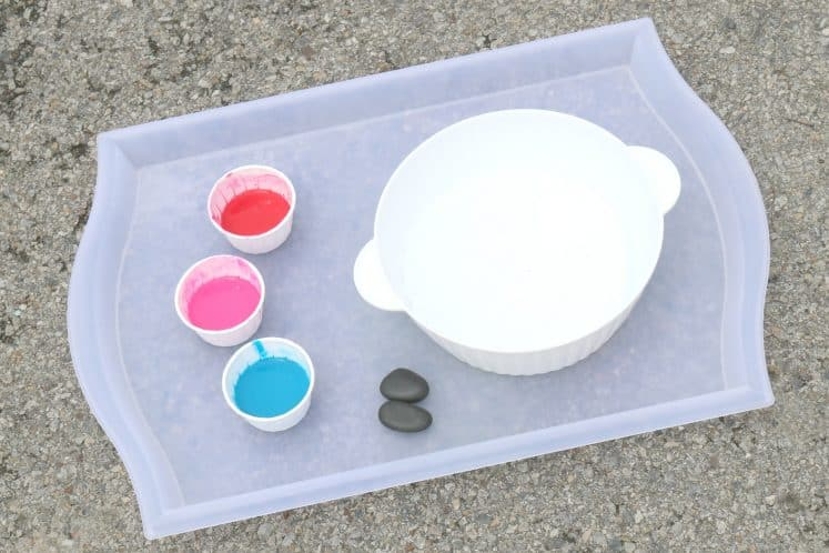 tray with small bowl, rocks, and cups of paint