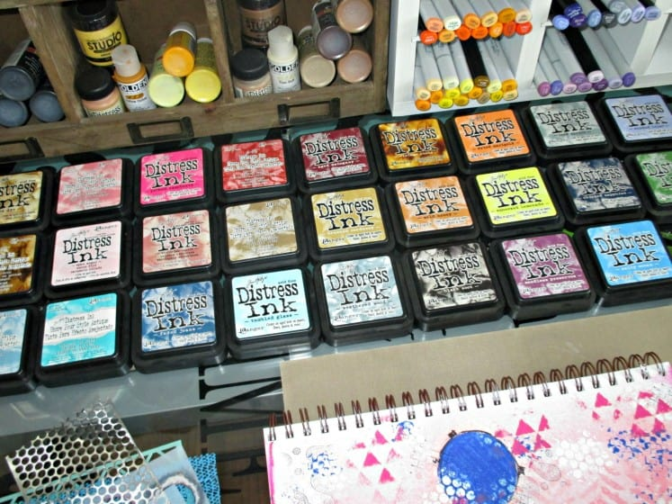 Distress Ink pads lined up on workspace