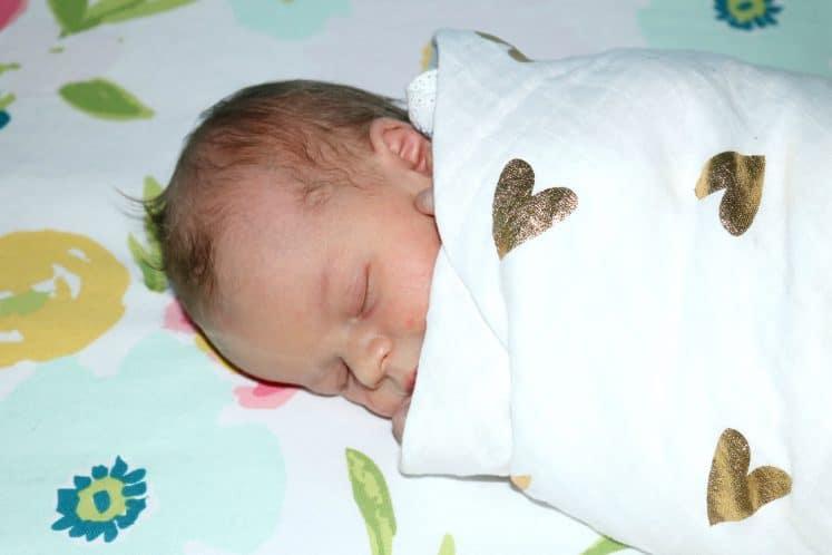 swaddled baby girl sleeping