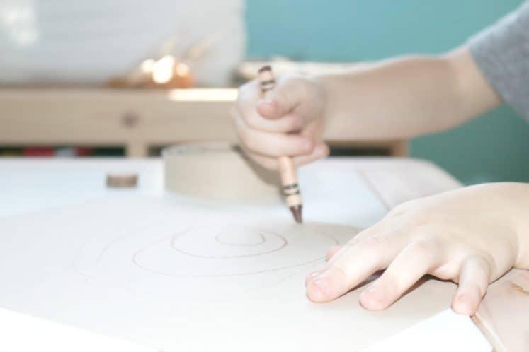 preschooler drawing tree rings on cardstock