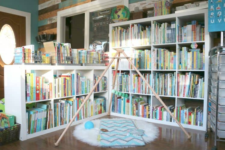 baby mobile in front of cube bookshelves filled with children's books