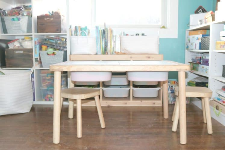 children's sensory table with stools in front of storage unit