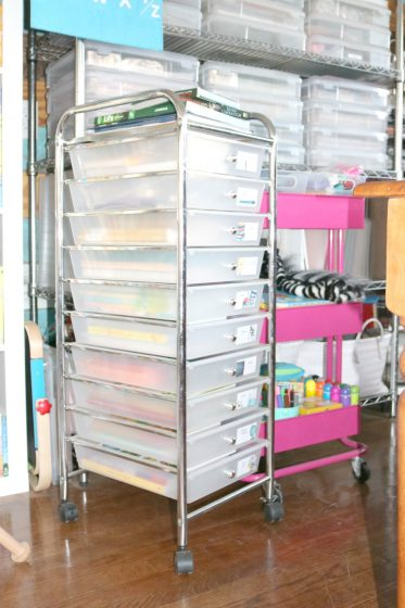 10-drawer and 3-tier rolling carts filled with homeschool curriculum