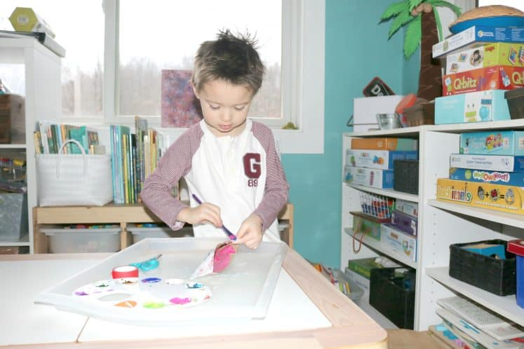 preschooler painting canoe craft