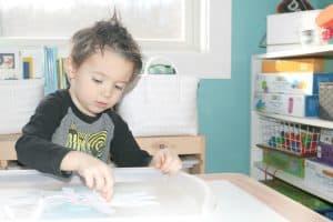 preschooler making A is for Angel door hanger