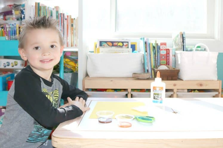 preschooler sitting at table ready to start beehive stamping art