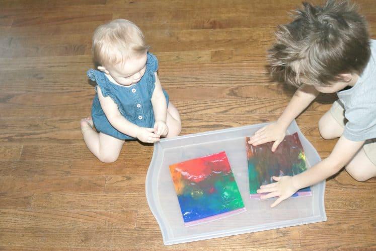 baby and preschooler exploring rainbow sensory bags