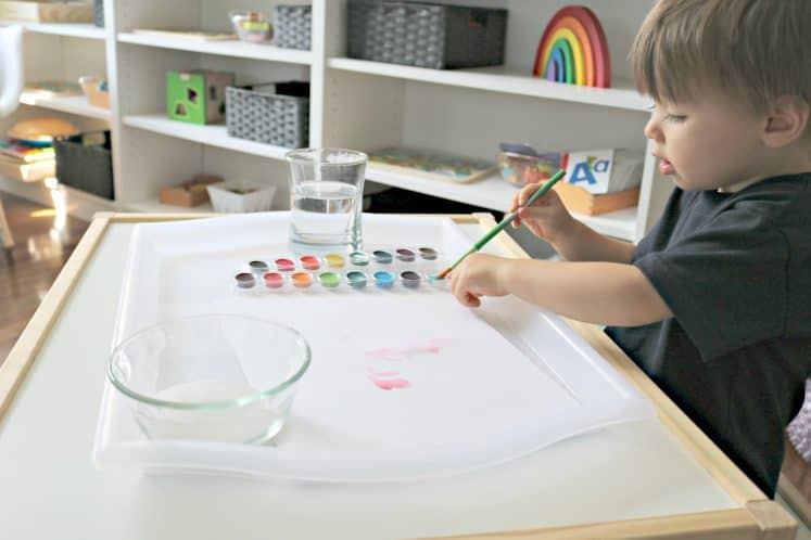 preschooler using watercolors for salt painting
