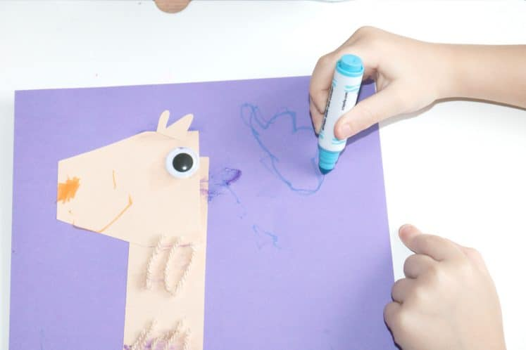 preschooler drawing blue cloud on llama craft