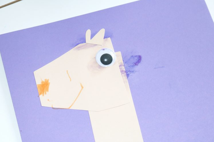 llama head made from cardstock with orange nose and wiggle eye