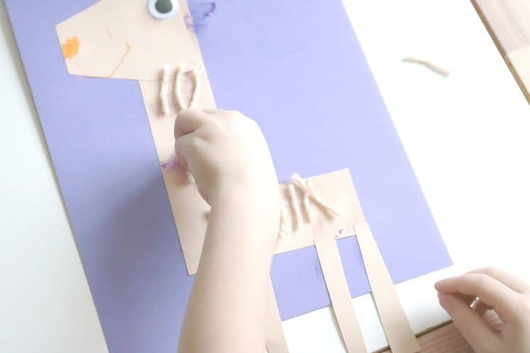 preschooler adding yard to llama zoo craft