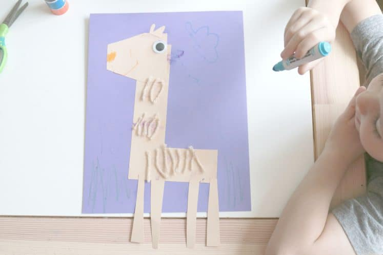 preschooler drawing clouds on llama letter craft