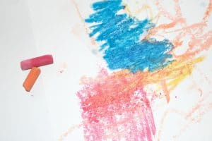 closeup of preschooler's chalk and water process art