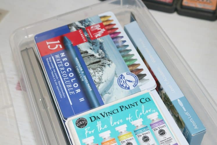 watercolors in clear plastic container