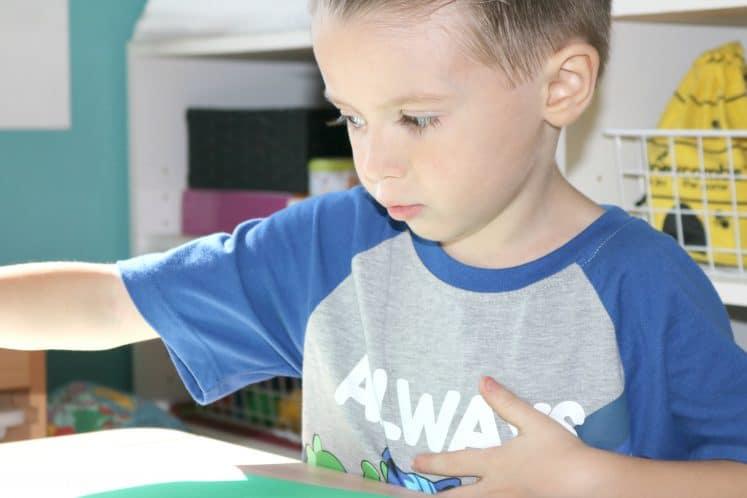 preschooler using pokey ball to make flower process art