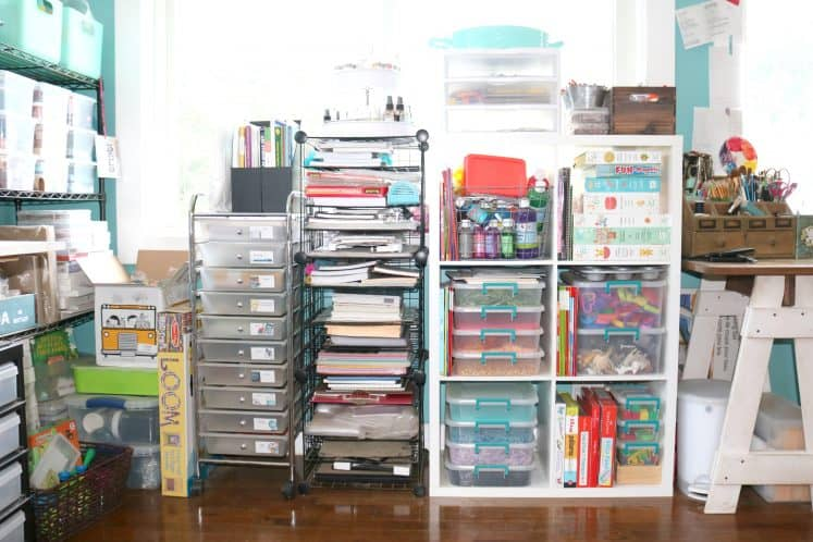 rolling cart and wire rack next to cube shelves filled with planners and art supplies