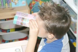 preschooler looking through DIY binoculars
