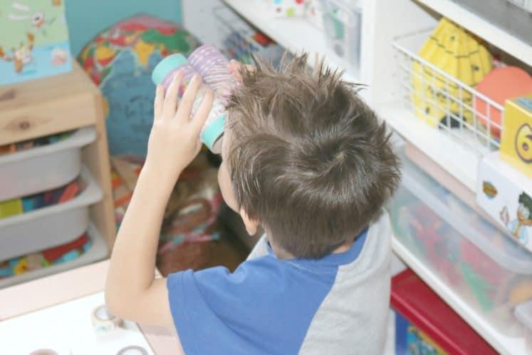 preschooler looking into DIY binoculars