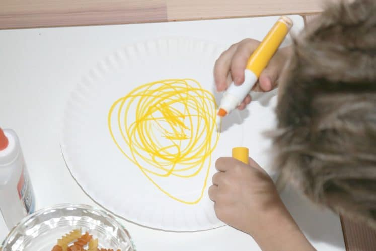 child coloring paper plate yellow