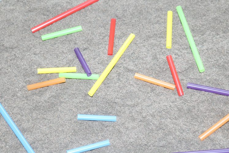cut-up pieces of straws of sand