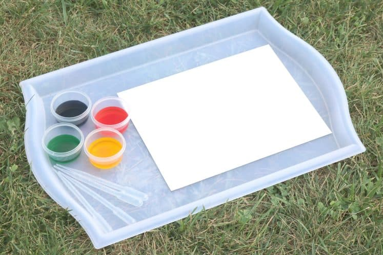 tray with white cardstock, watercolors, and eyedroppers