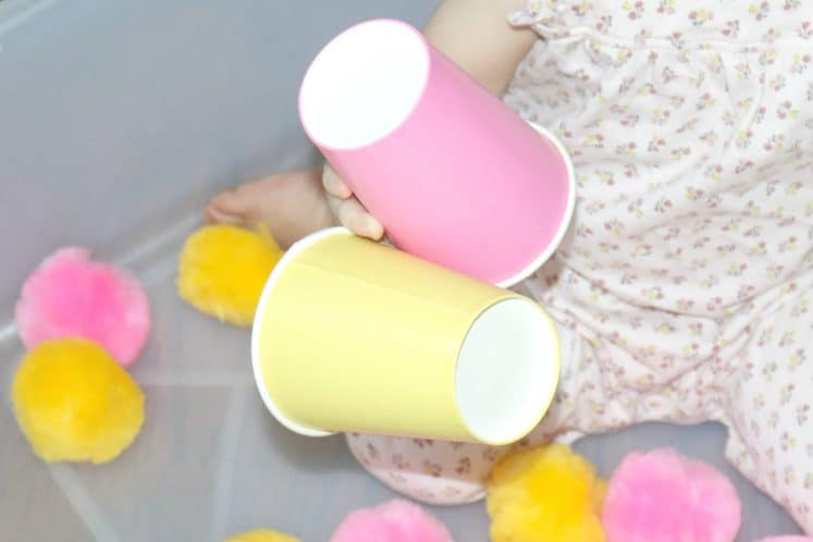 toddler holding paper cups