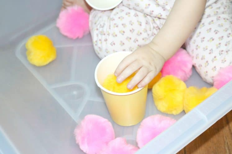 yellow pompom in yellow paper cup