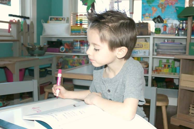 child practicing handwriting