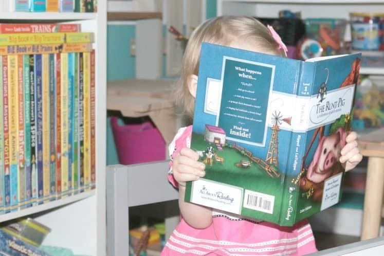 preschooler reading a book