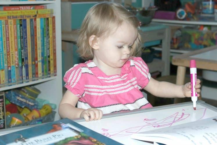 preschooler scribbling with marker