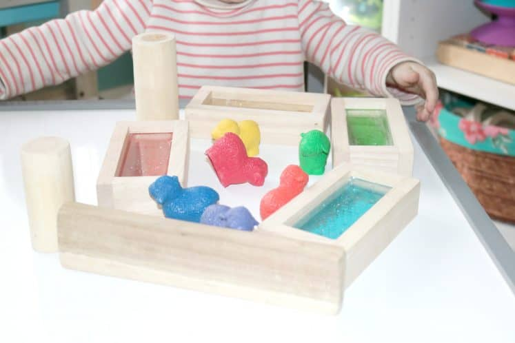 toddler building fences using wooden blocks