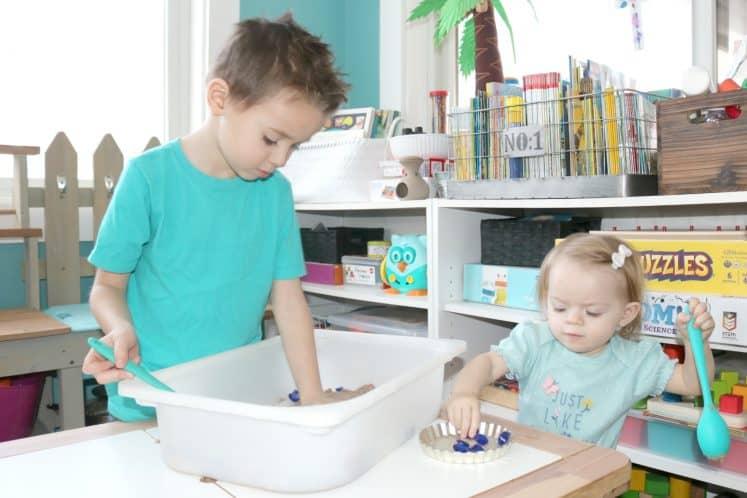 child digging for treasure in sensory bin